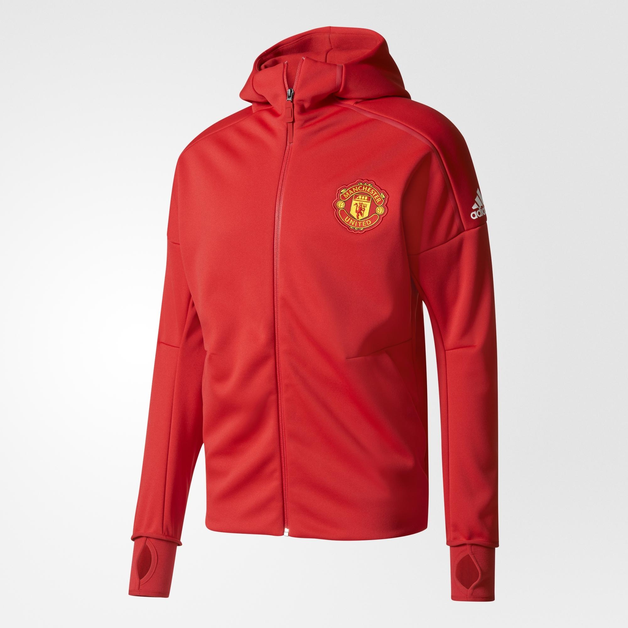 ... in placeWoven Manchester United FC badge on left chestLarge  high-density print adidas brandmark on left shoulderRegular fit100%  polyester interlock